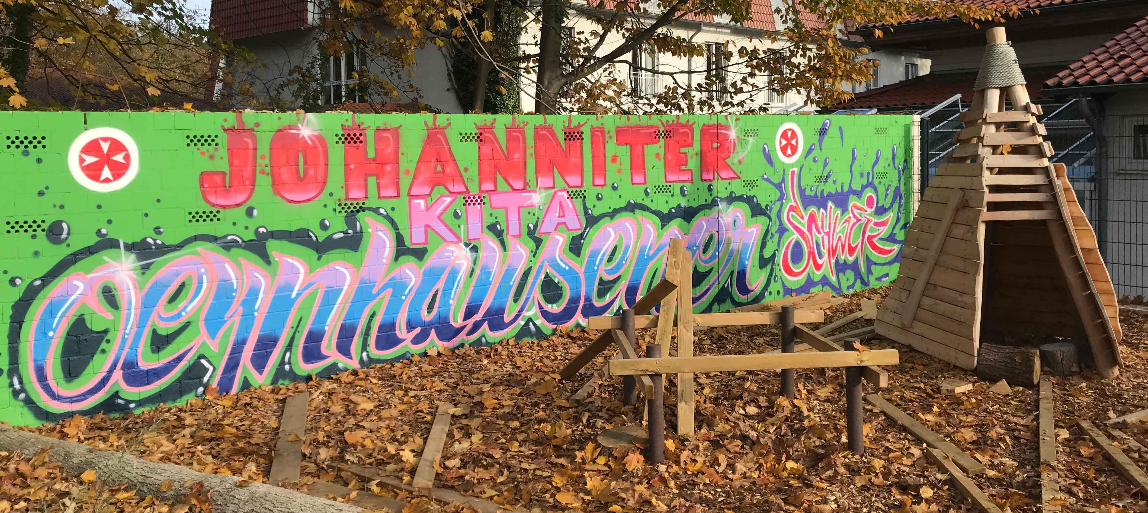 Graffiti-Wand Kita Oeynhausener Schweiz  im Außenbereich