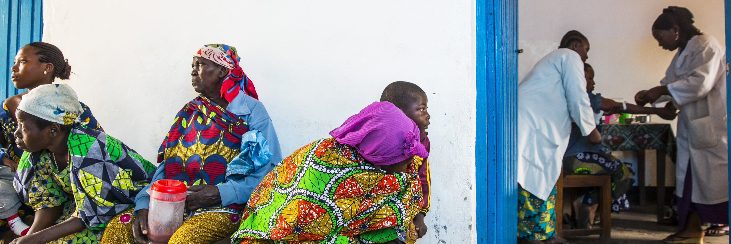 Women waiting in front of a doctor's office