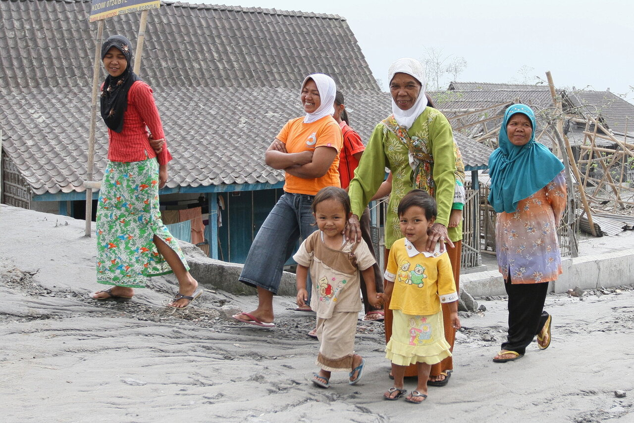 Women and children on a street in Indonesia