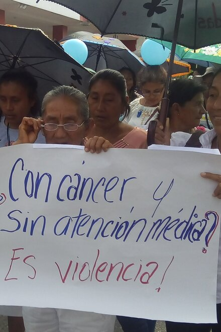 "A demonstration. You can see a poster that says ""Cancer without medical treatment? This is violence!"""