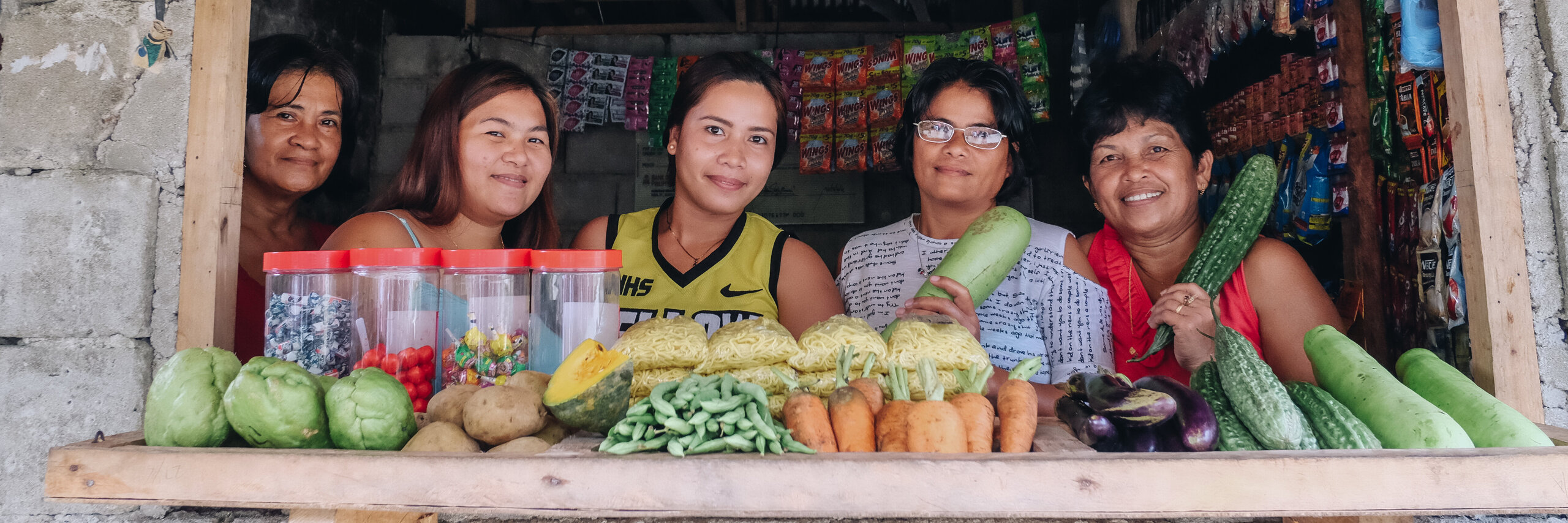 Women in a vegetable store in the Philippines