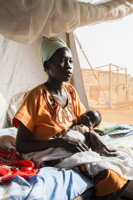 A woman with her baby in a health center