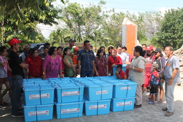 People with boxes full of sanitary and hygiene materials
