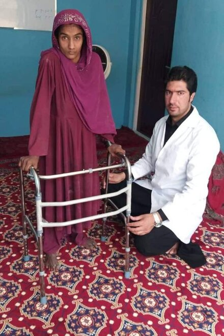 Woman with disability receives walking aid