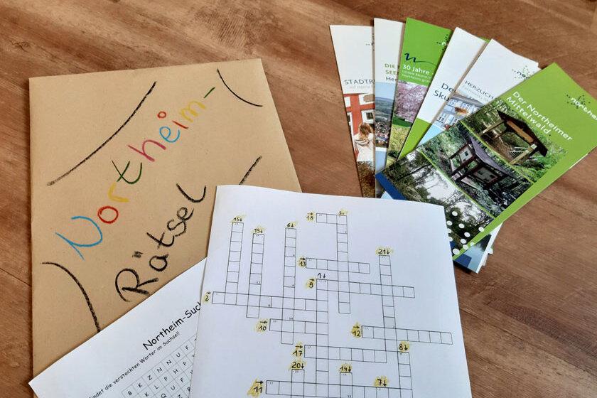 Umschlag mit Rätseln und Infomaterial zur Stadt Northeim.